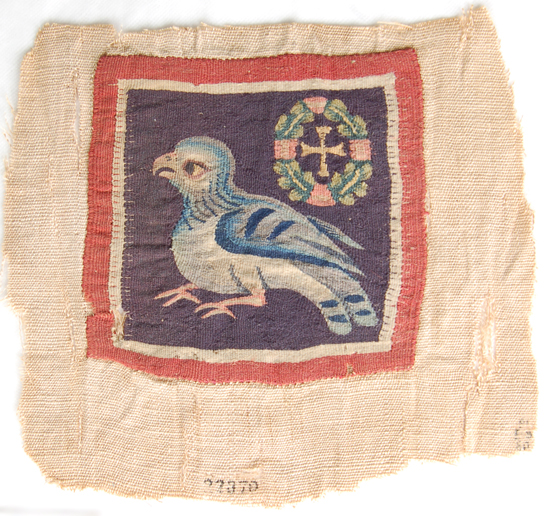 Square tapestry panel in multi-coloured wool depicting a bird and a cross-within-wreath (EA 22870). Egypt, Akhmim, 4th-7th century AD. The tapestry panel is applied on a linen plain weave, cut out when discovered at the end of the 19th century