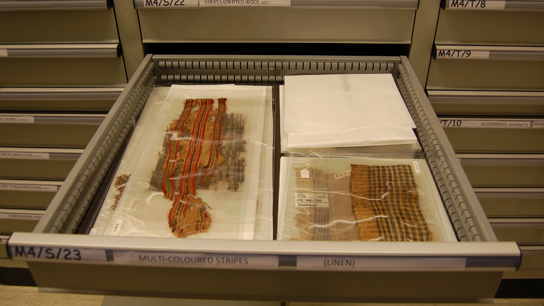 Late Antique Egyptian textiles re-housed in storage drawers after study, documentation and photography