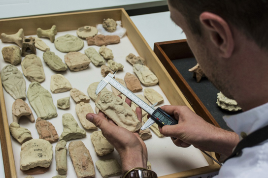 Dr Gareth Brereton investigating a terracotta relief from Ur