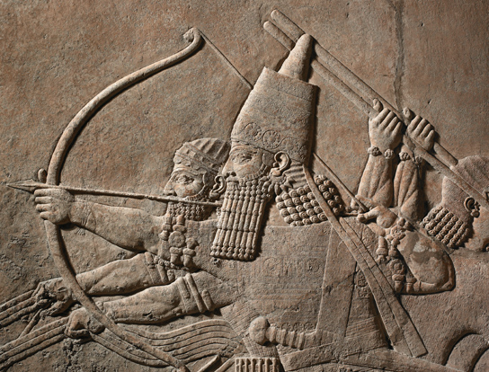 Detail of relief from the North Palace of Ashurbanipal, Nineveh, northern Iraq. The king is in his chariot shooting arrows at succession of lions (ME 124867)