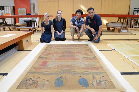 Mrs Qiu with her assistants and Mr Chu Hao from Shanghai Museum, after the painting has been lined and its facings removed.