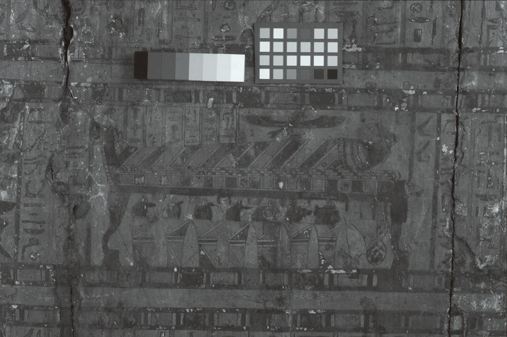 An infrared-reflected (IRR) image of the mummy and jars scene found on the lid of the outer coffin of Nestawedjat (EA22813A). Illumination with highly penetrative infrared radiation allows greater contrast between the infrared opaque materials, such as the carbon-based pigments (which appear dark) used for the under drawings and outlines, and infrared transparent materials (which appear lighter).
