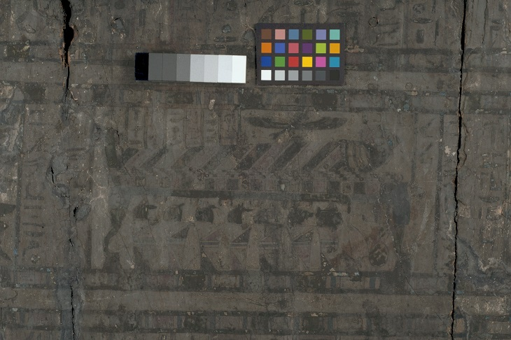 A visible reflected light image of the mummy and jars scene found on the lid of the outer coffin of Nestawedjat (EA22813A), showing the blackened surface of the lid. Much of the detail of this scene is illegible with the naked eye.