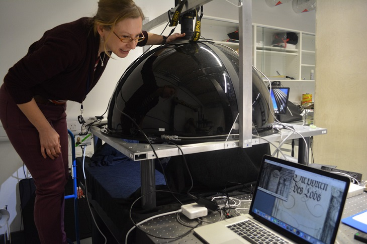 Conservator Sam Taylor taking RTI images in the Museum's imaging lab