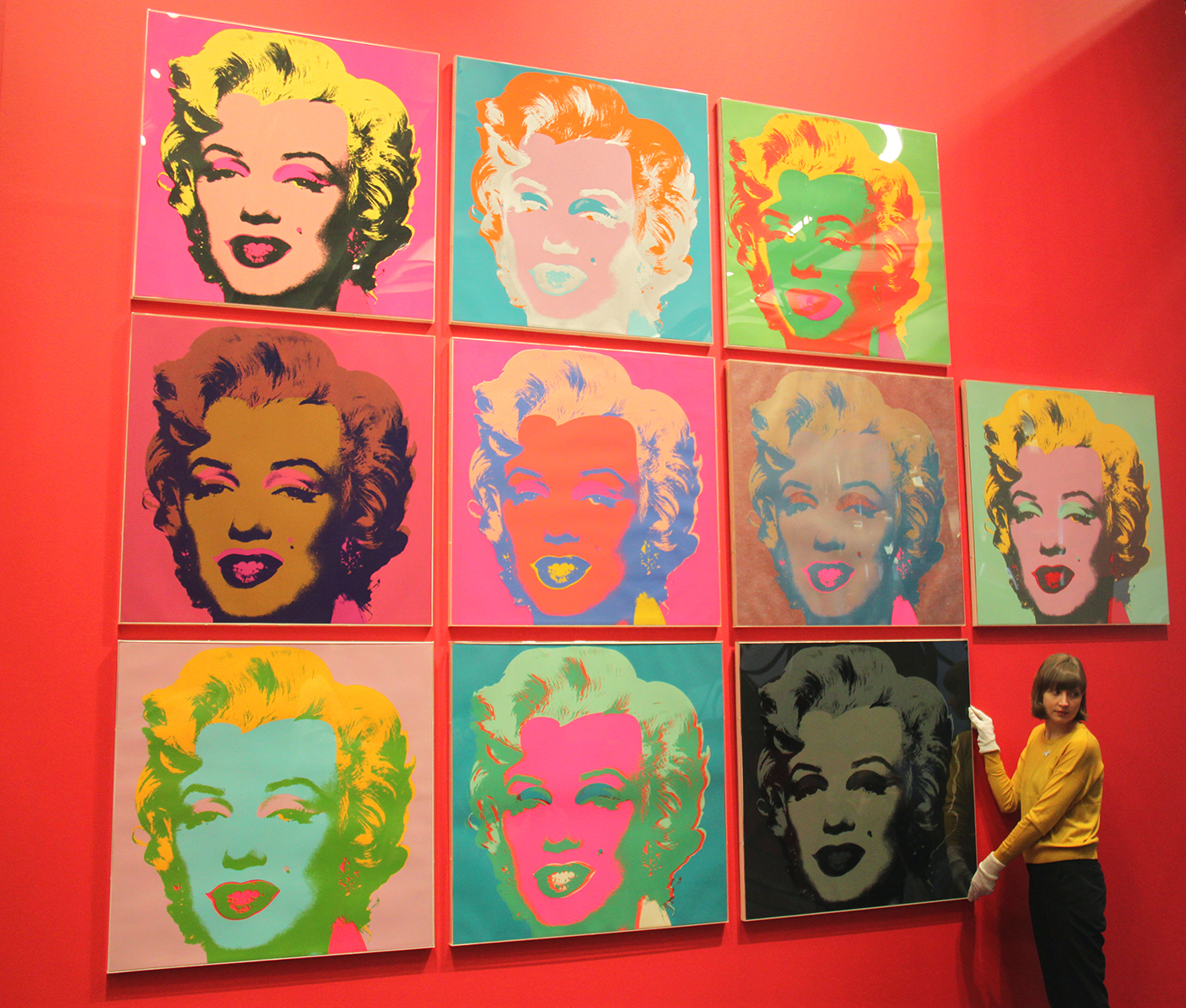 Andy Warhol's series of 10 Marilyns being installed in the exhibition The American Dream: pop to the present.