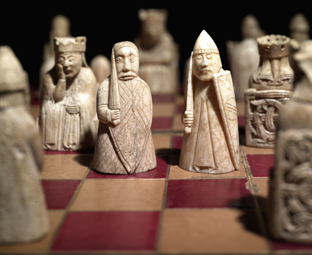 The Lewis Chessmen on a chess board.