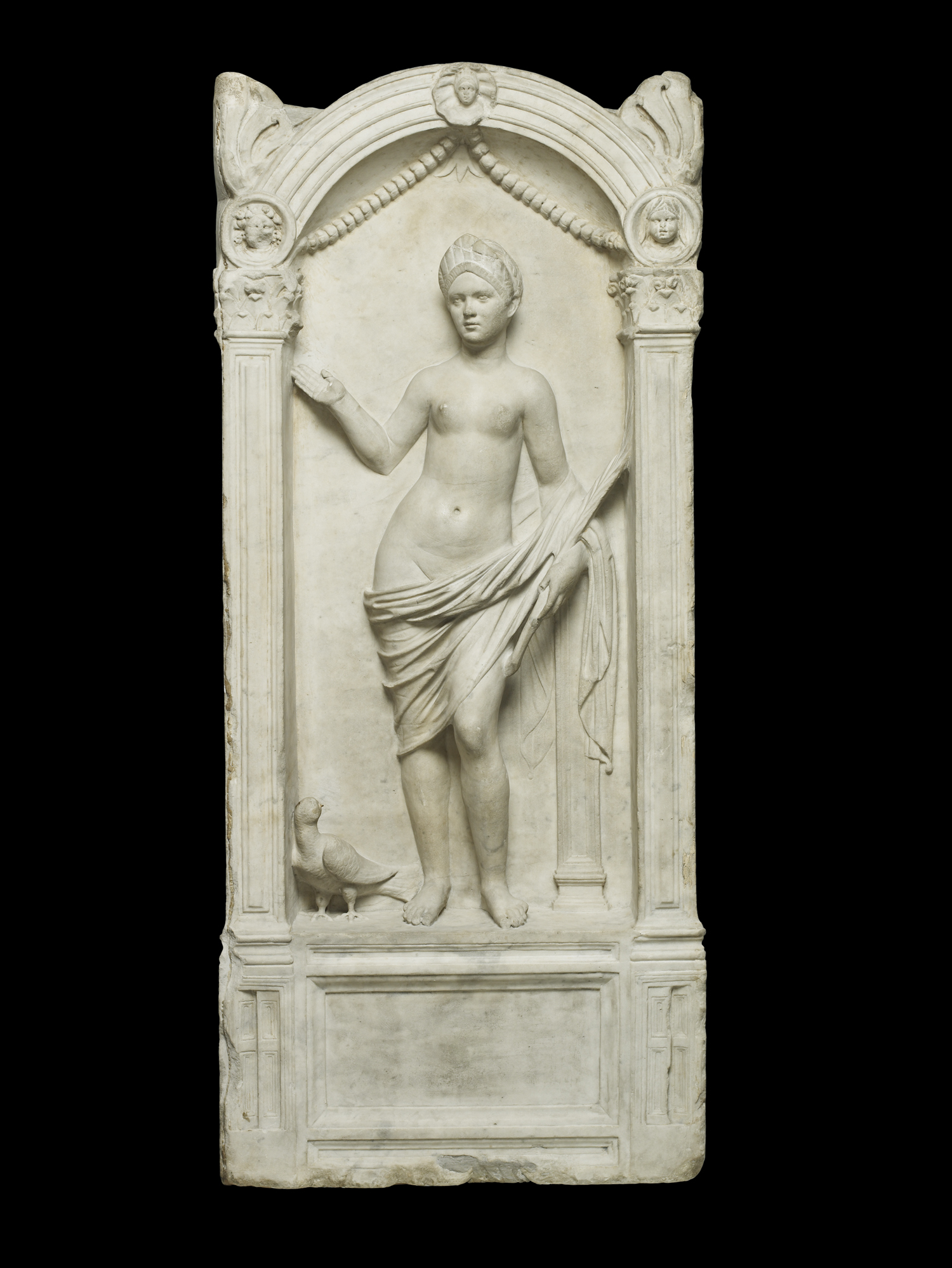 Marble relief from a tomb with a portrait of a woman as victorious Venus. Roman, c. AD 100-120.