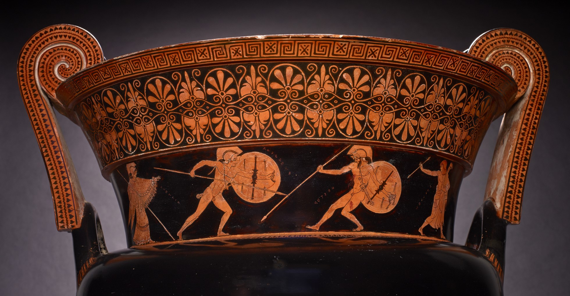 Achilles and Hector face each other in combat.