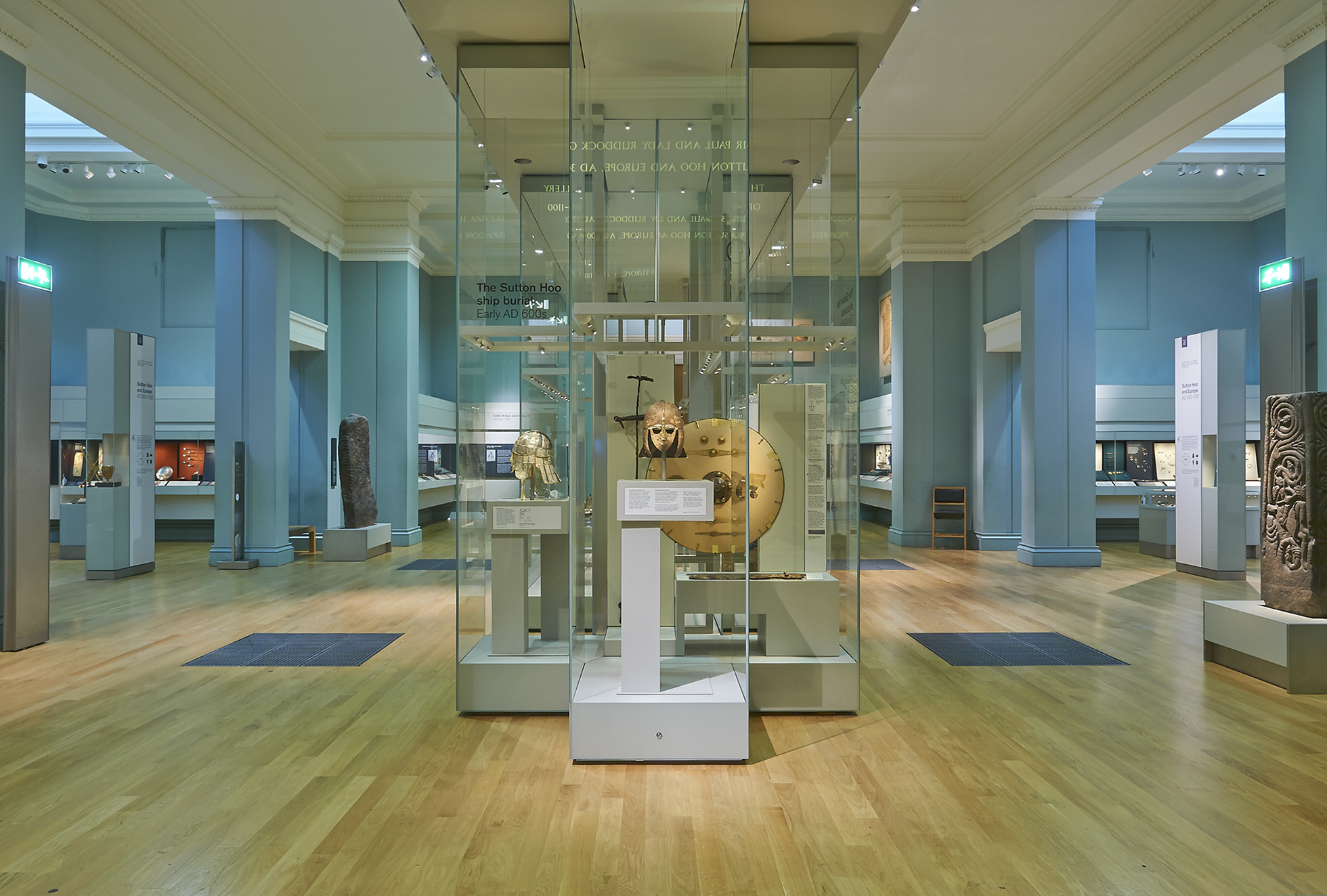 A photograph of the Sutton Hoo finds on display in glass cases in the Museum