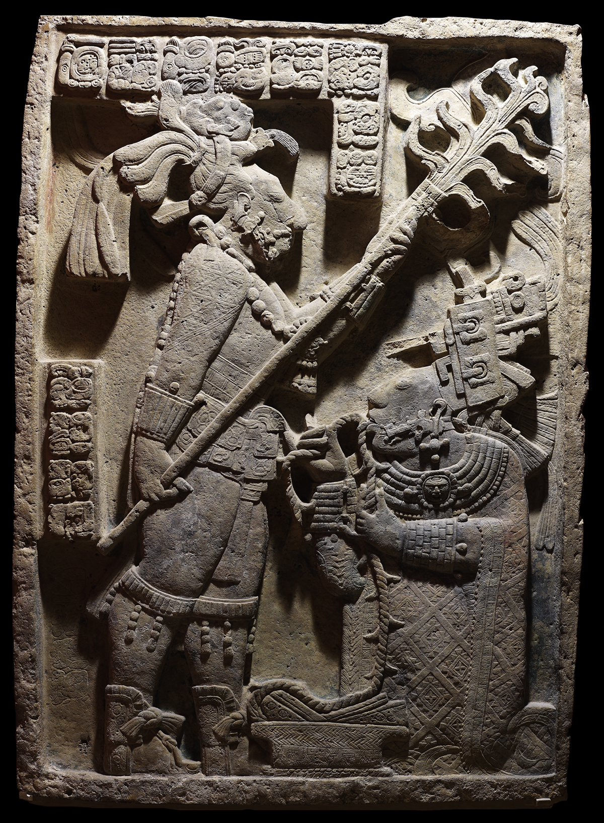Stone lintel showing Lady K'abal Xook participating in a bloodletting ritual.