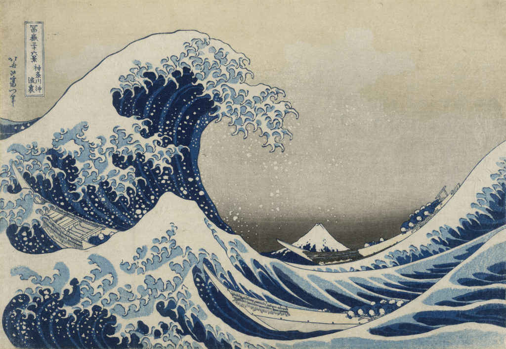 An early print of the Great Wave. A huge wave on the left looms over three small boats which struggle in the spray and swell. Mount Fuji can be seen in the background.