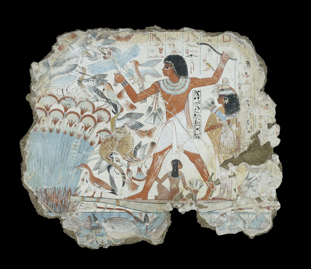 A painted wall-panel showing a man standing on a small papyrus boat, with his wife standing to the right, and young daughter sitting underneath his legs. On the left are reeds and a flock of different birds, some flying, some standing. A brown stripey cat jumps up to catch a bird in its mouth.