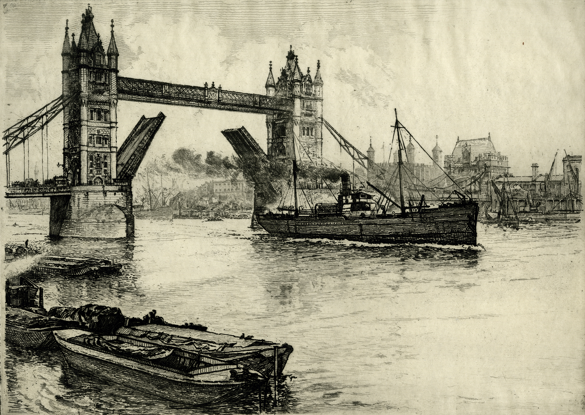 A view of Tower Bridge with gates open for a cargo steamship to pass, from right to left. There are moored boats in foreground to the left, and the Tower and other buildings are seen on the opposite bank.