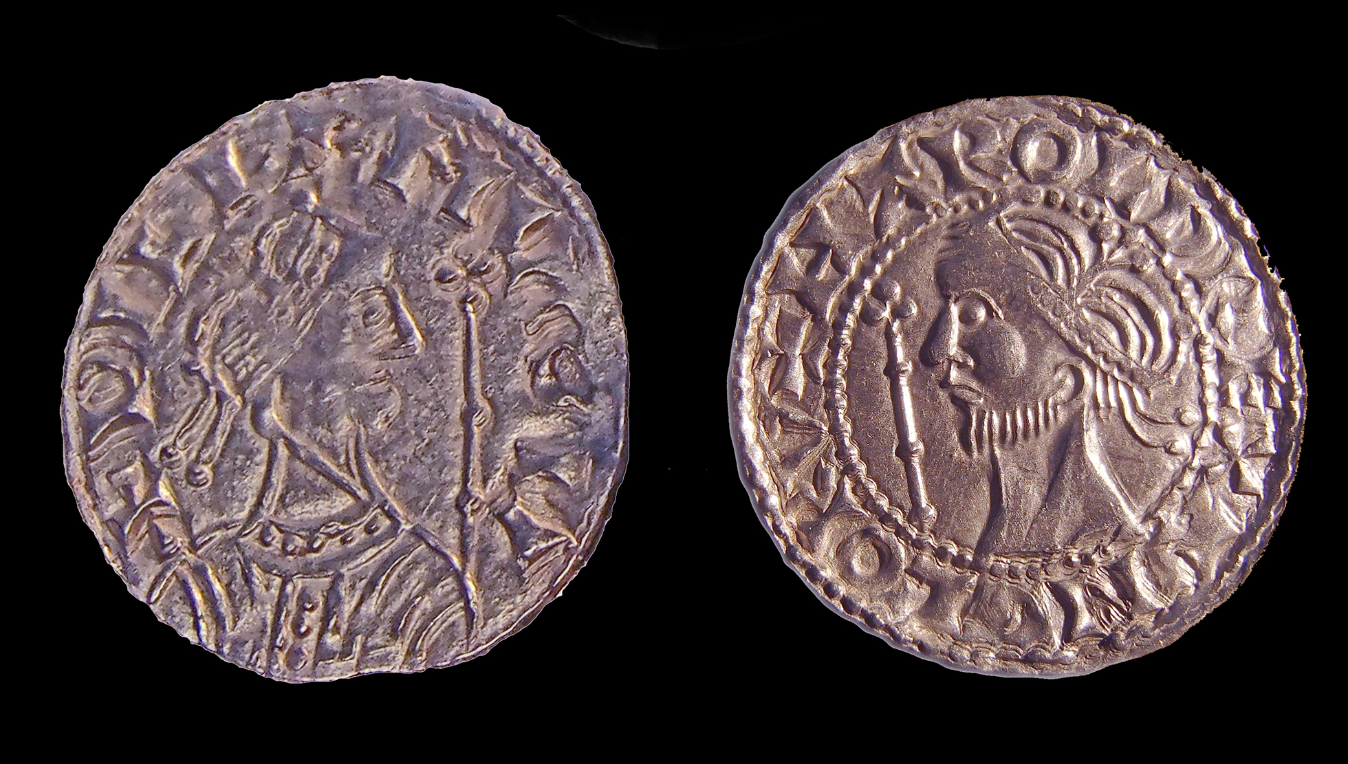 Two copper-coloured coins from the Watlington Hoard, on the left is William the Conqueror and on the right is Harold II.