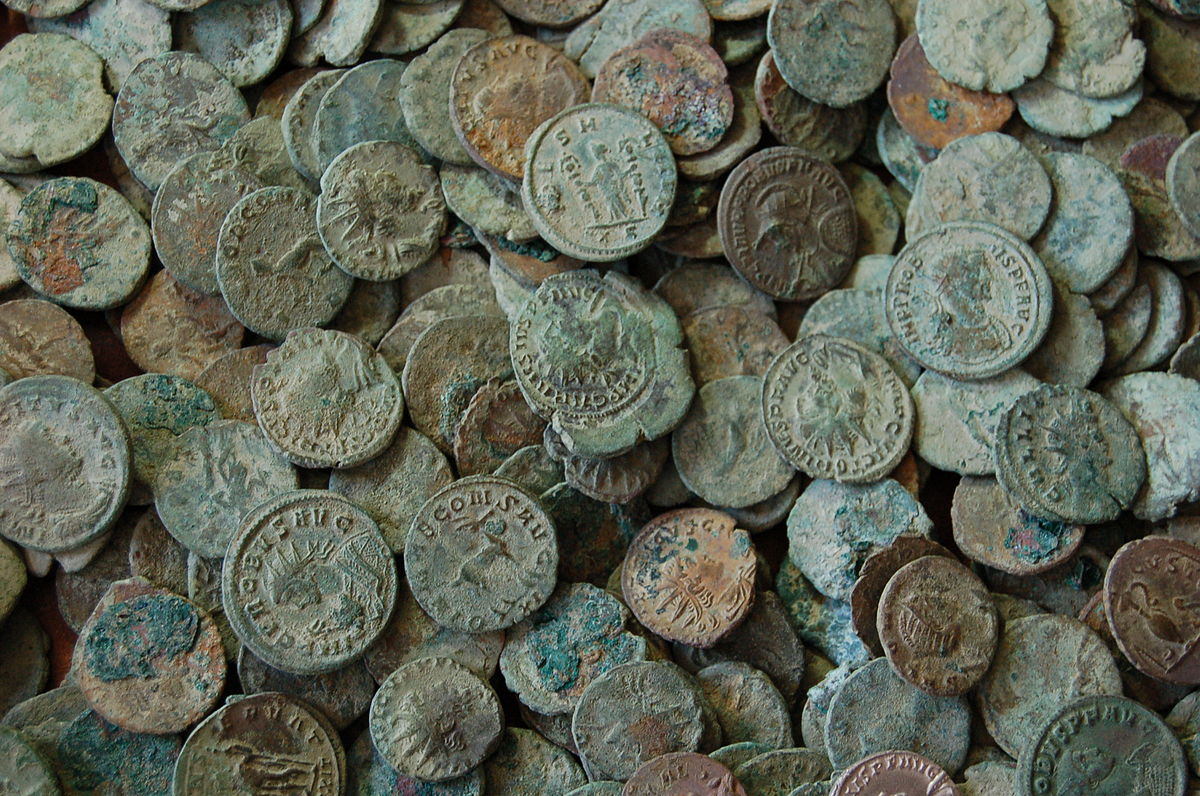 A photograph of a pile of blue-green coins from the Frome Hoard.