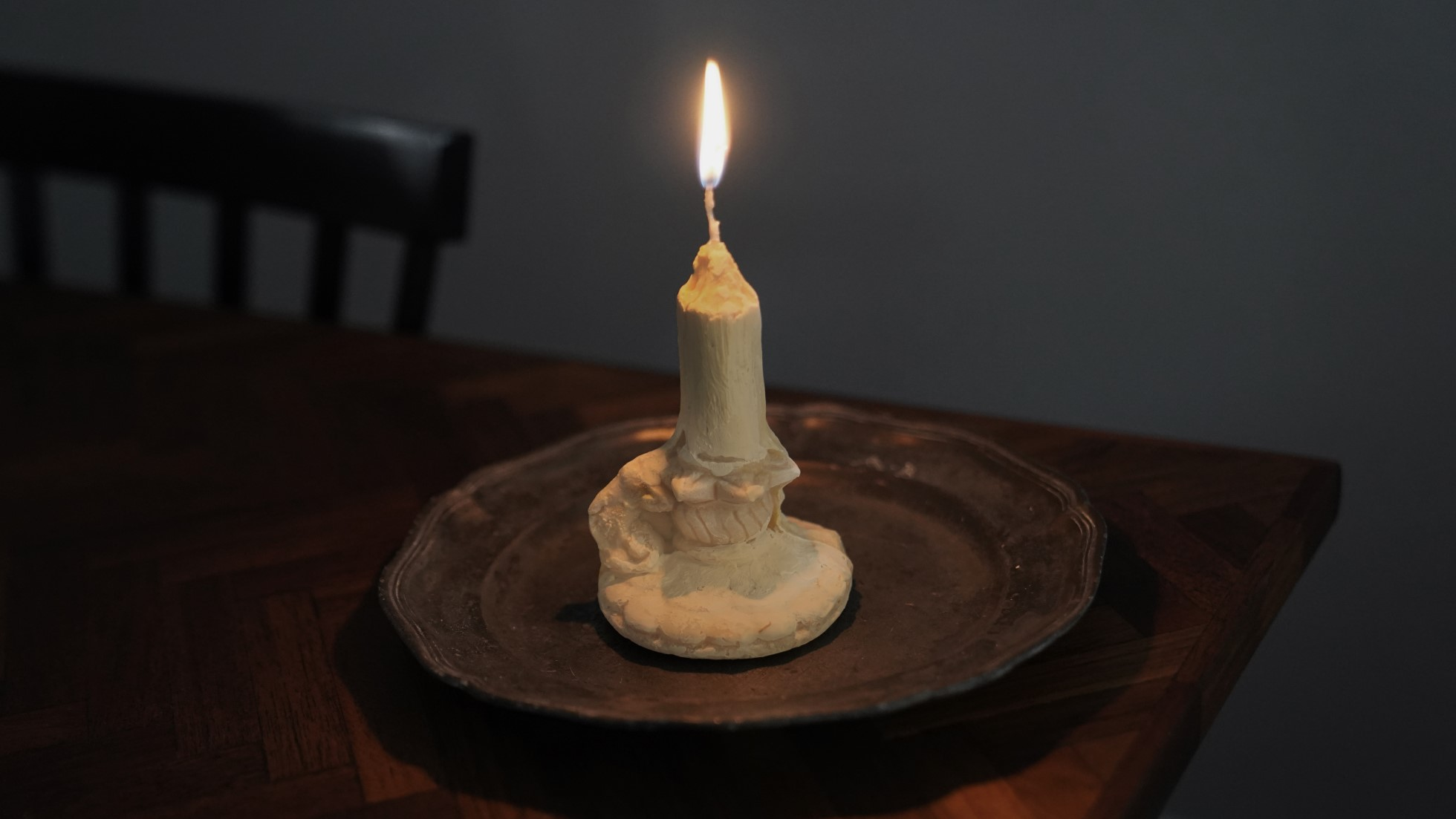 A photograph of an ice cream 'candle' made using the mould above. The wick is alight.
