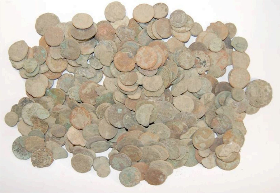 A selection of Roman 'grots' - corroded green and brown coins with very little recognisable detail.