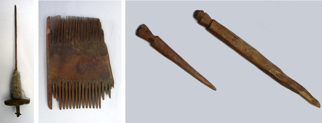Three photographs of products made by artisans. On the left is a spindle whorl – a tool from the local weaving trade made of wood – with cotton still attached to it. In the centre is an ebony comb with fine teeth on one side and coarser teeth on the other. On the right are two carved wooden hair toggle pins: pointed at one end with notches at the other end to form a head.