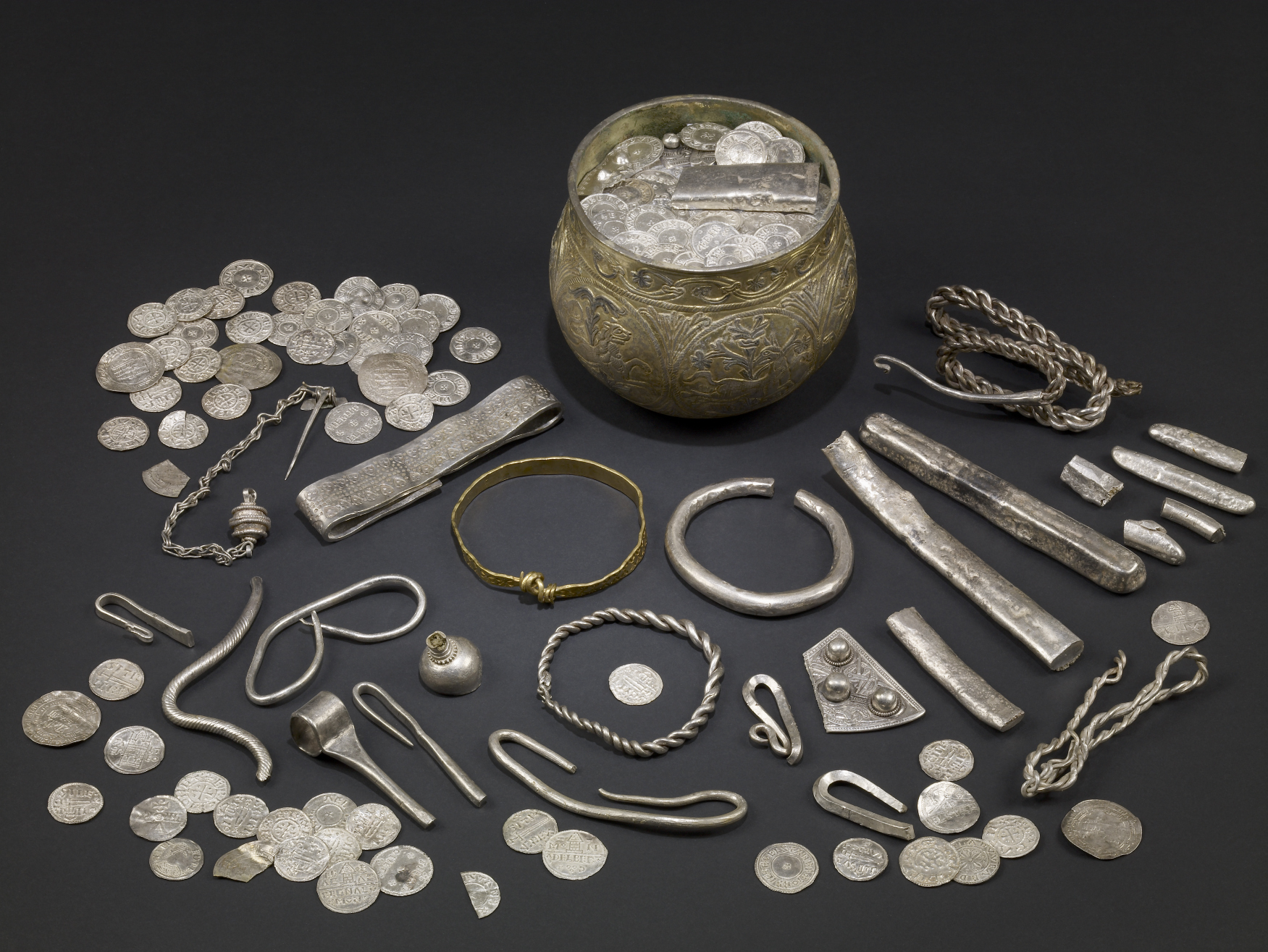A selection of objects from the Vale of York Hoard, including jewellery, coins and hack silver.
