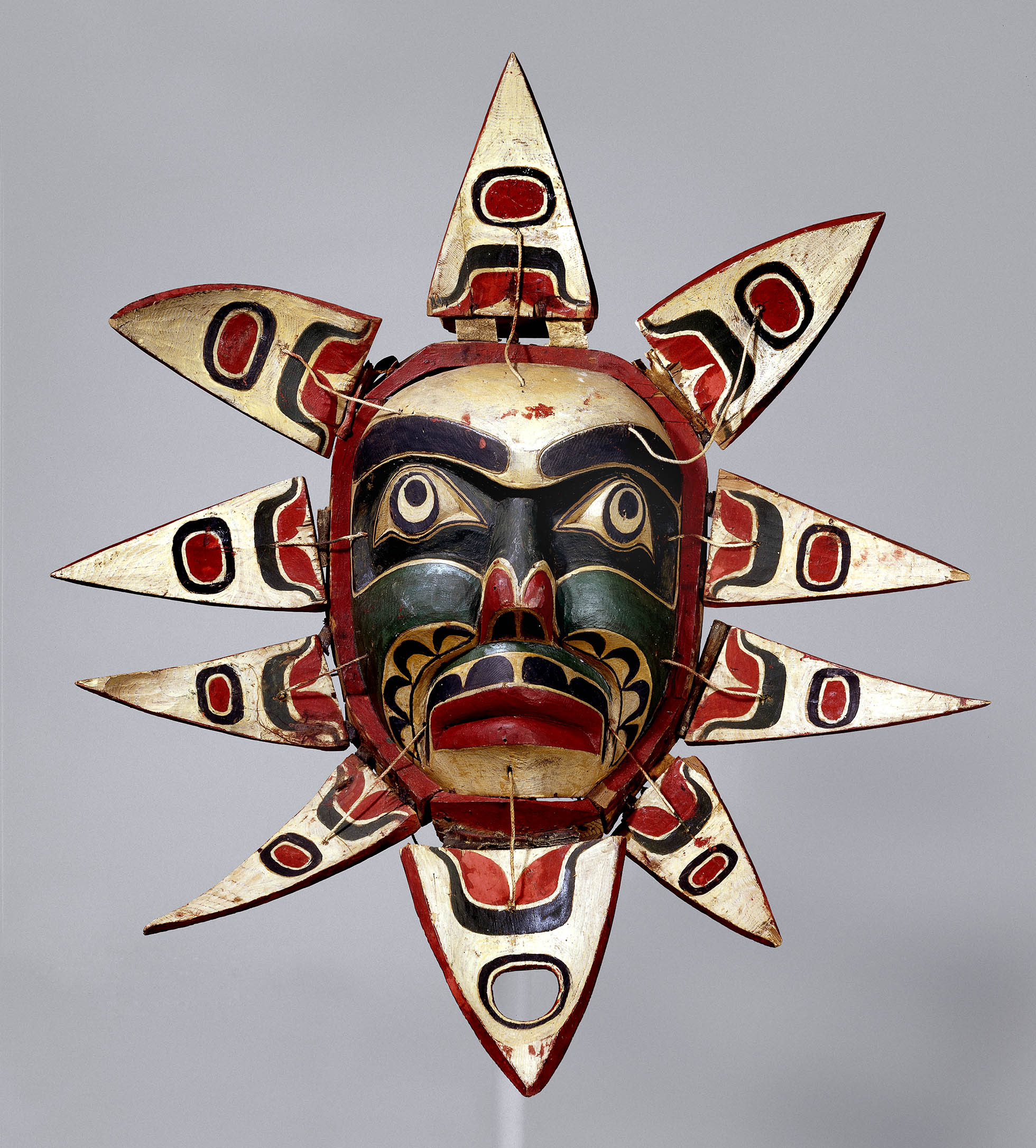 Image of wood and leather mask.