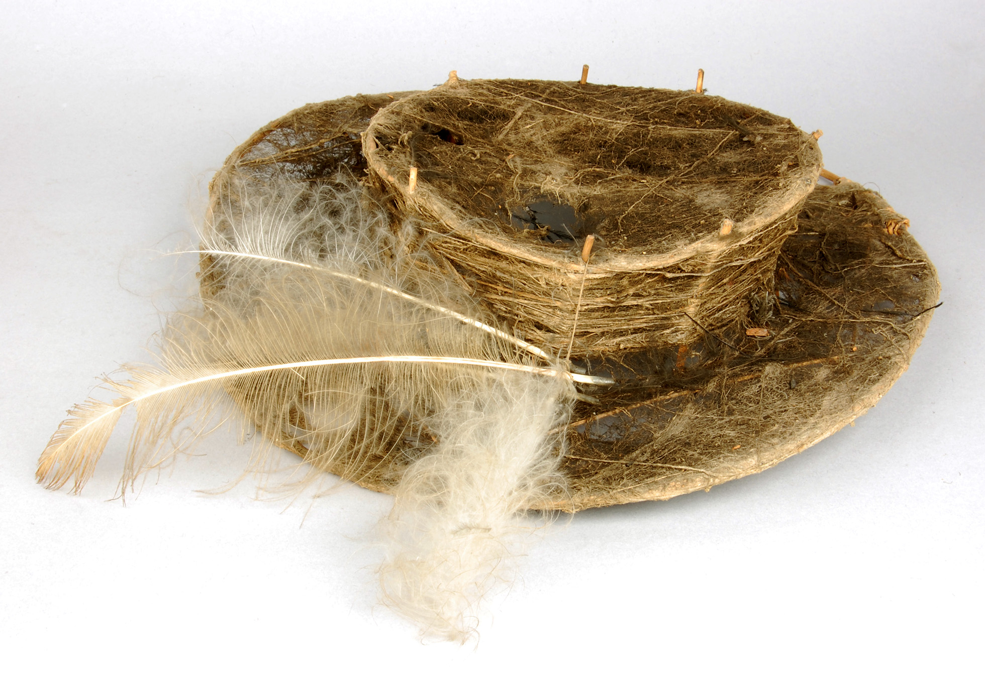 Image of hat made from mixture of organic materials.