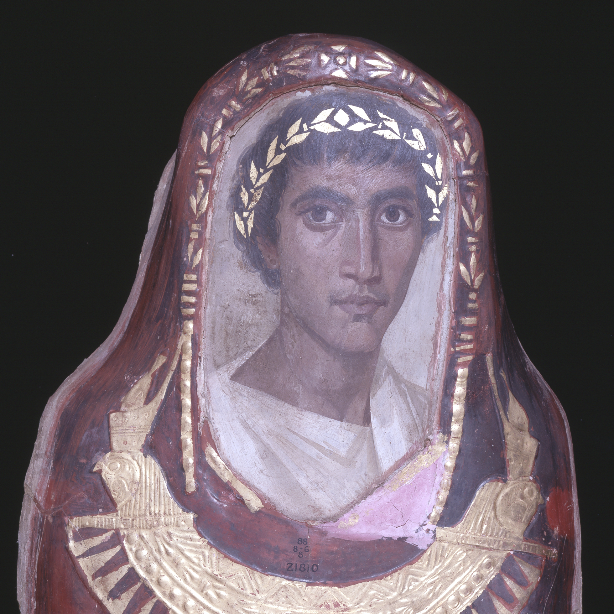 The limewood portrait-panel of a Greek youth, aged 19-21, named Artemidorus in a red body-case with gold leaf decoration.