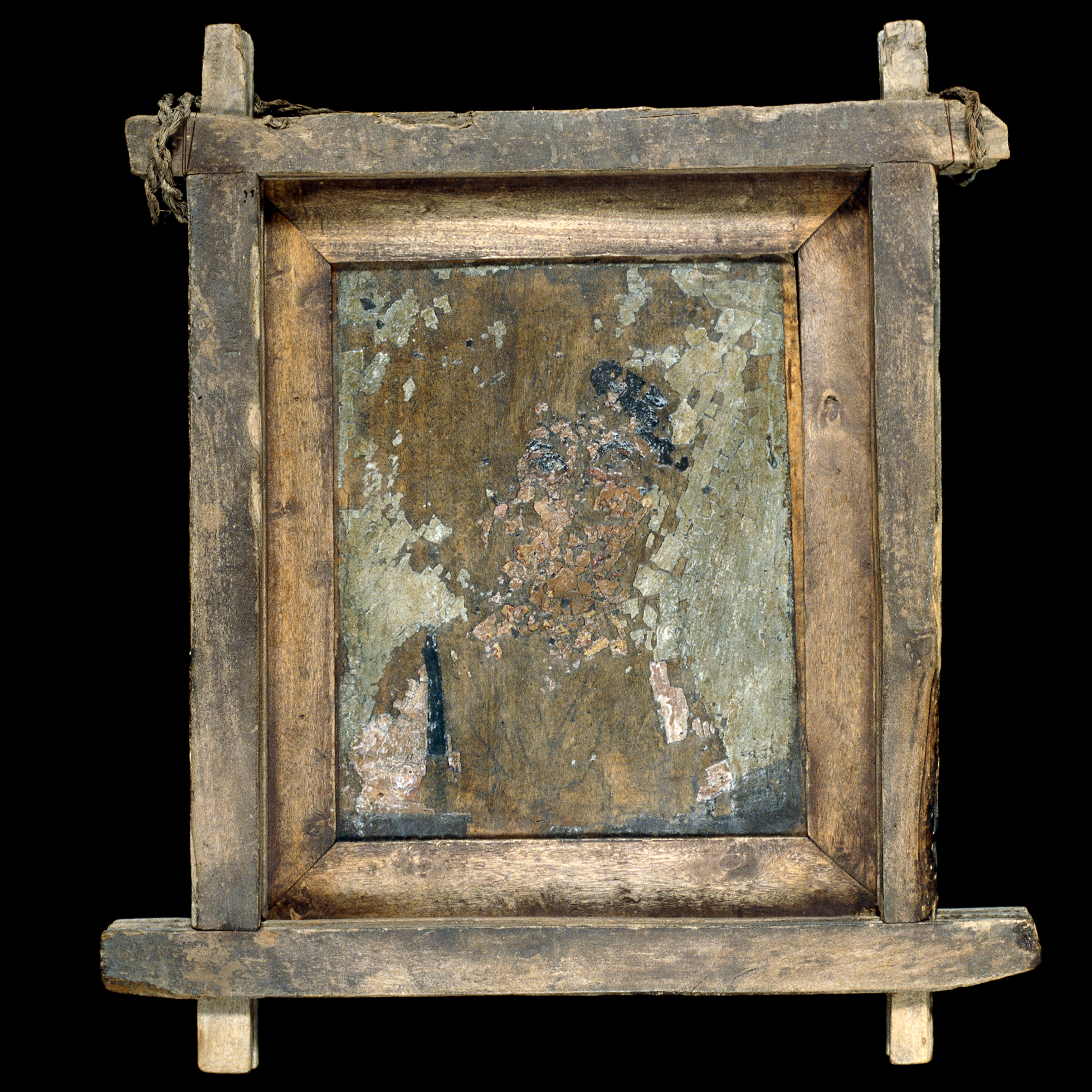 A framed wooden panel with a portrait of a woman, although the paint is badly damaged and flaking.