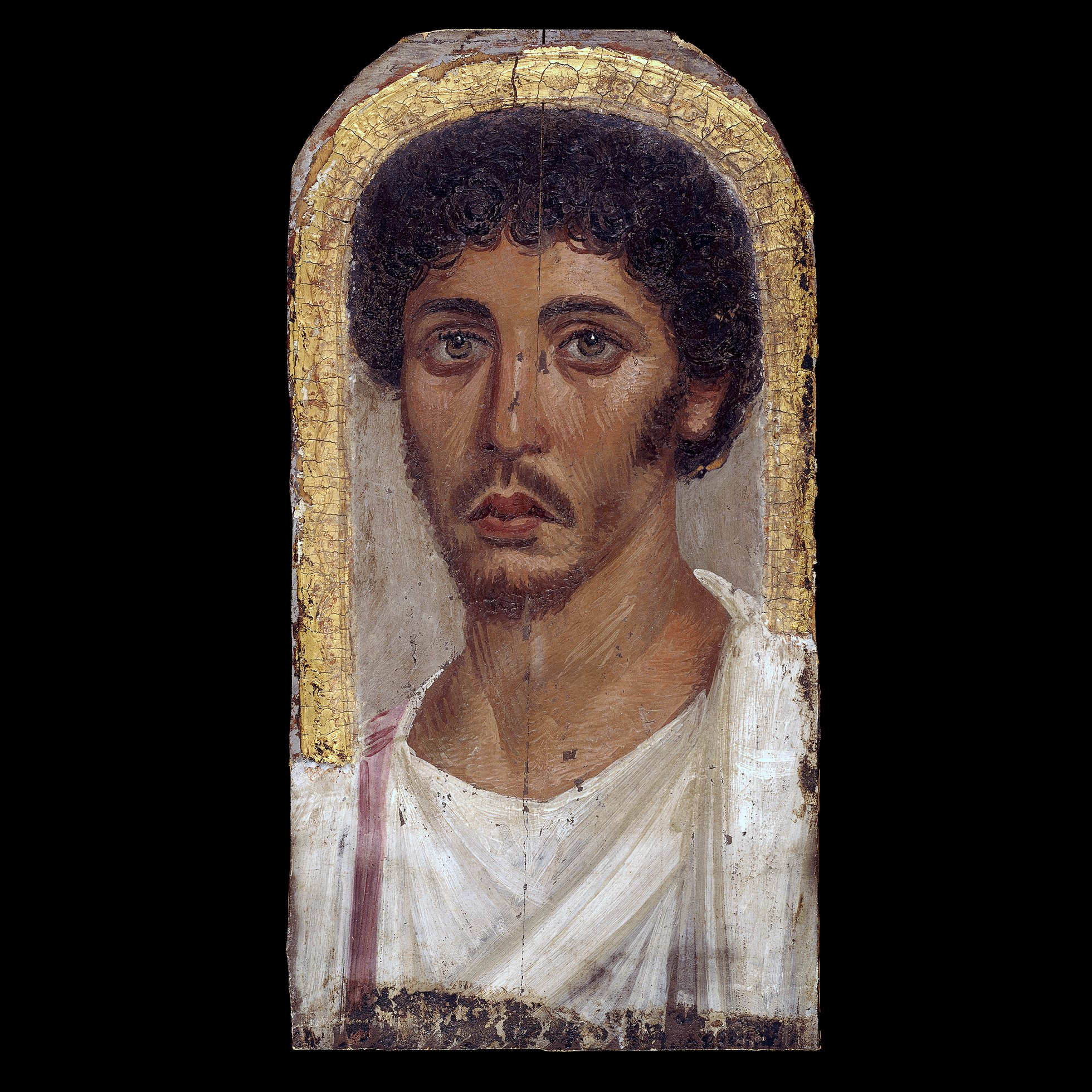 A detailed and lifelike portrait of a young man, with dark brown curly hair, a moustache and beard. He is wearing a white tunic with a purple stripe, and the portrait is enclosed by a gold frame.