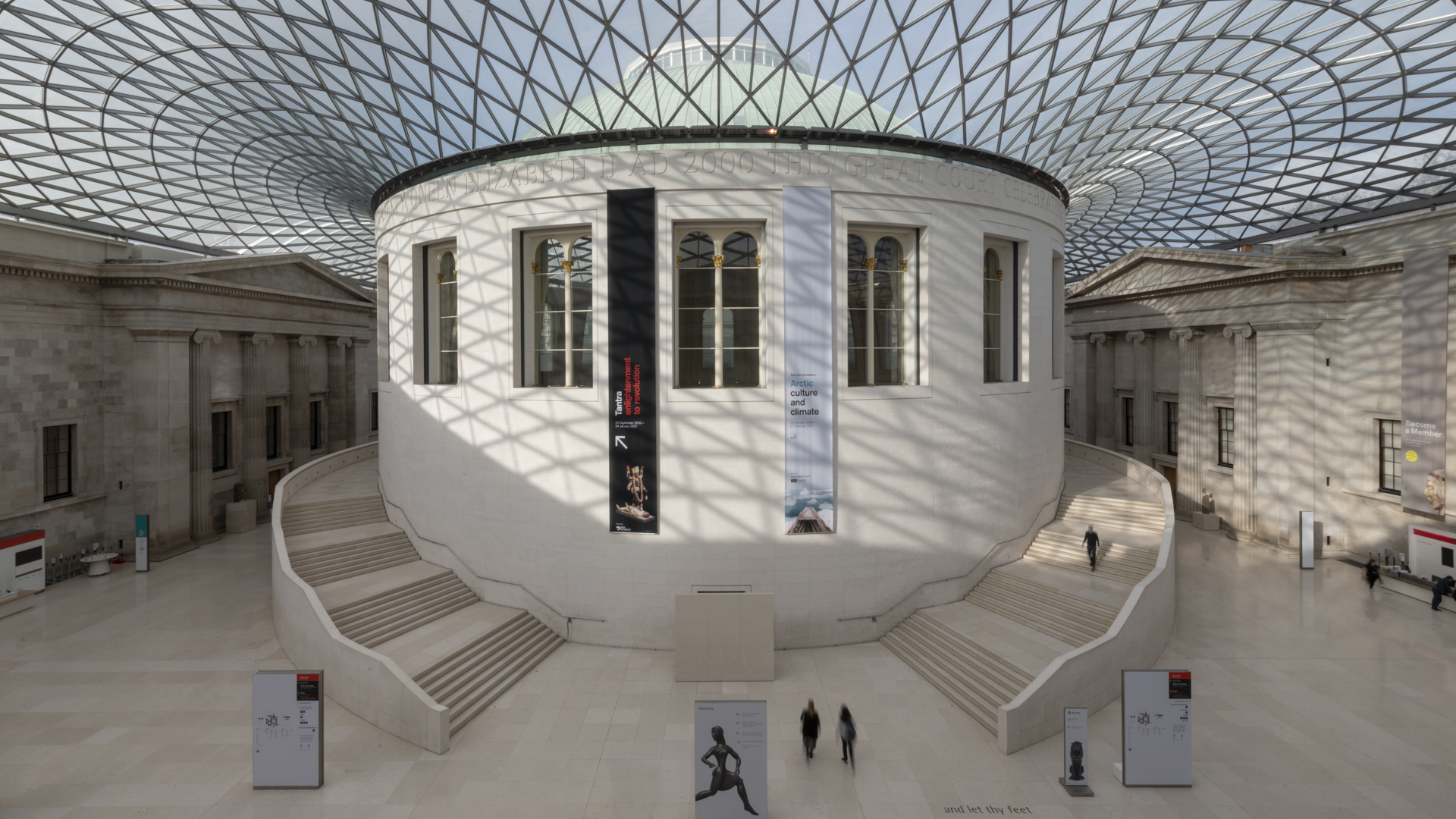 A photo of the Great Court, showing the glass and steel roof, with the round reading room in the centre.