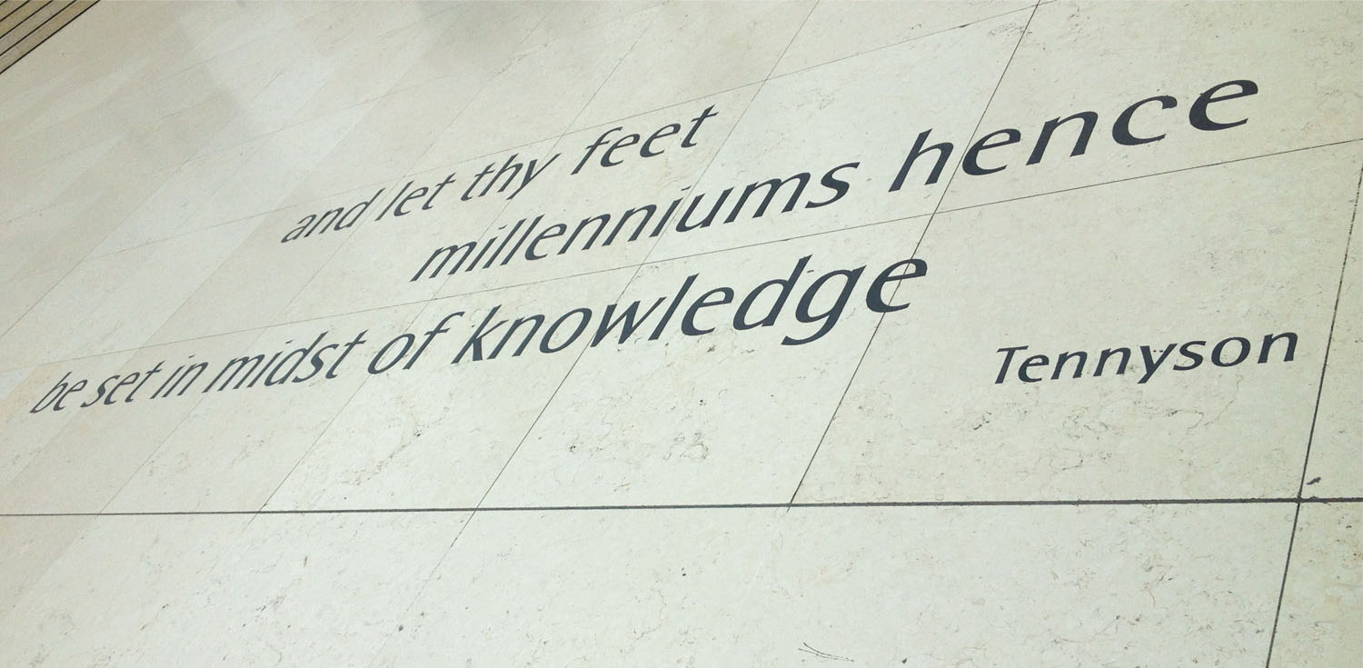 A close-up photo of the Tennyson quote inscribed onto the white floor of the Great Court.