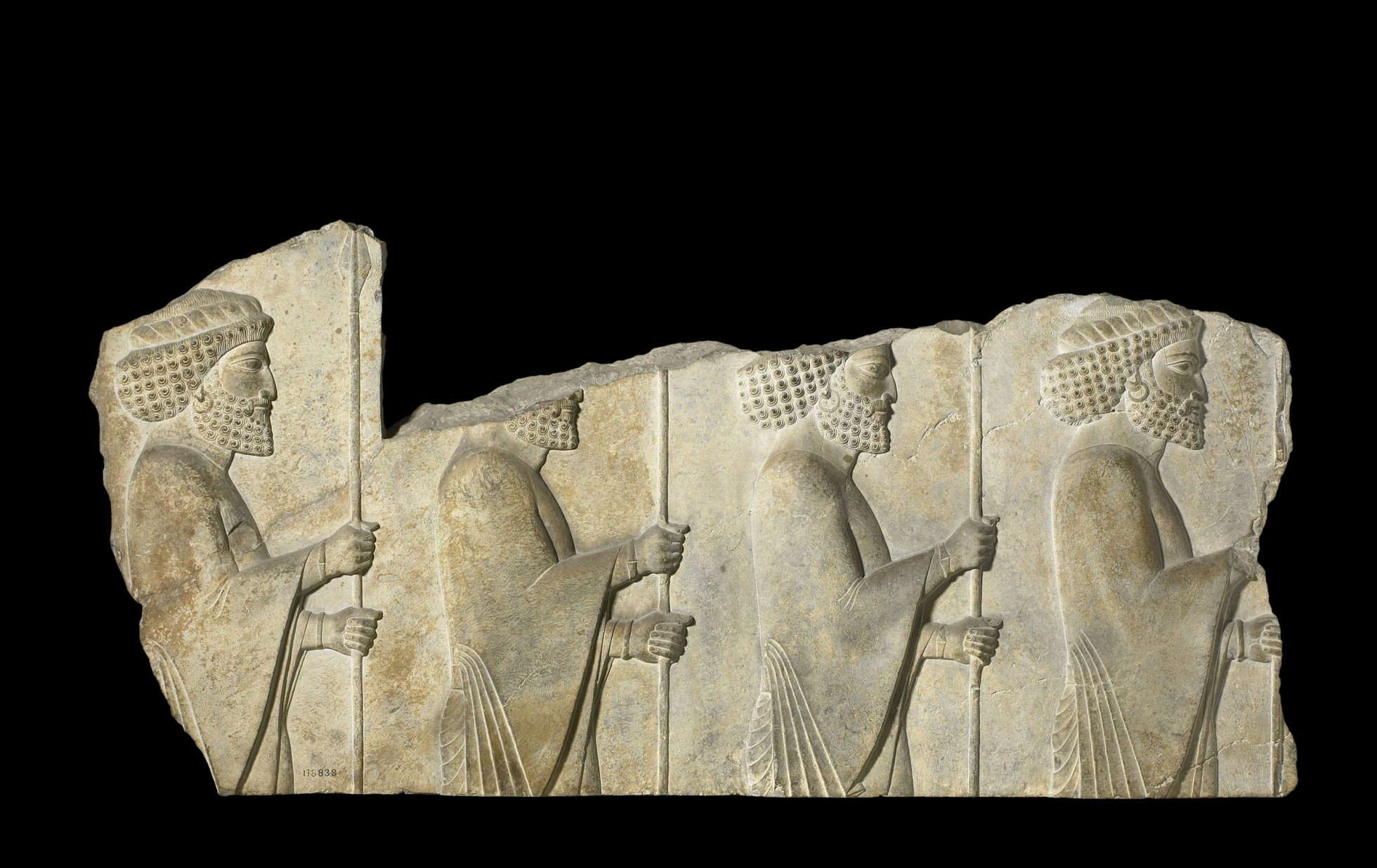 Fragment shows four guardsmen with spears, advancing right, wearing Persian dress with bracelets and ear-rings