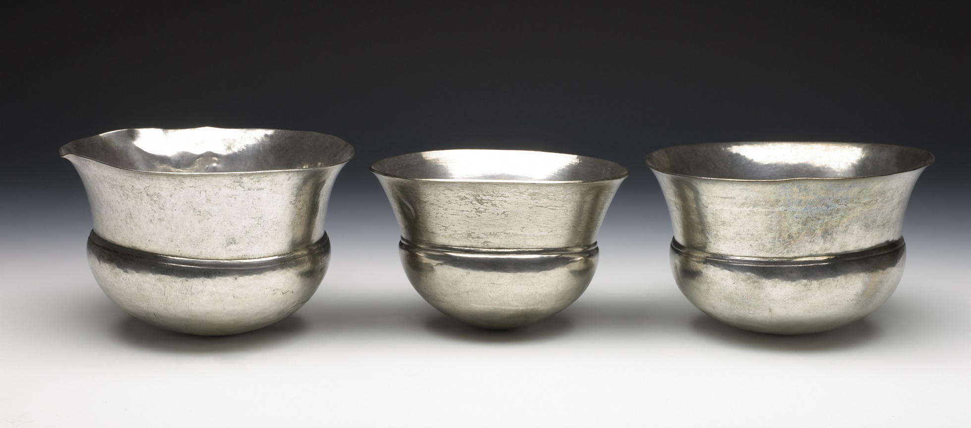 Deep bowl hammered from a single, thick piece of silver sheet, flared outwards above 'shoulder' line