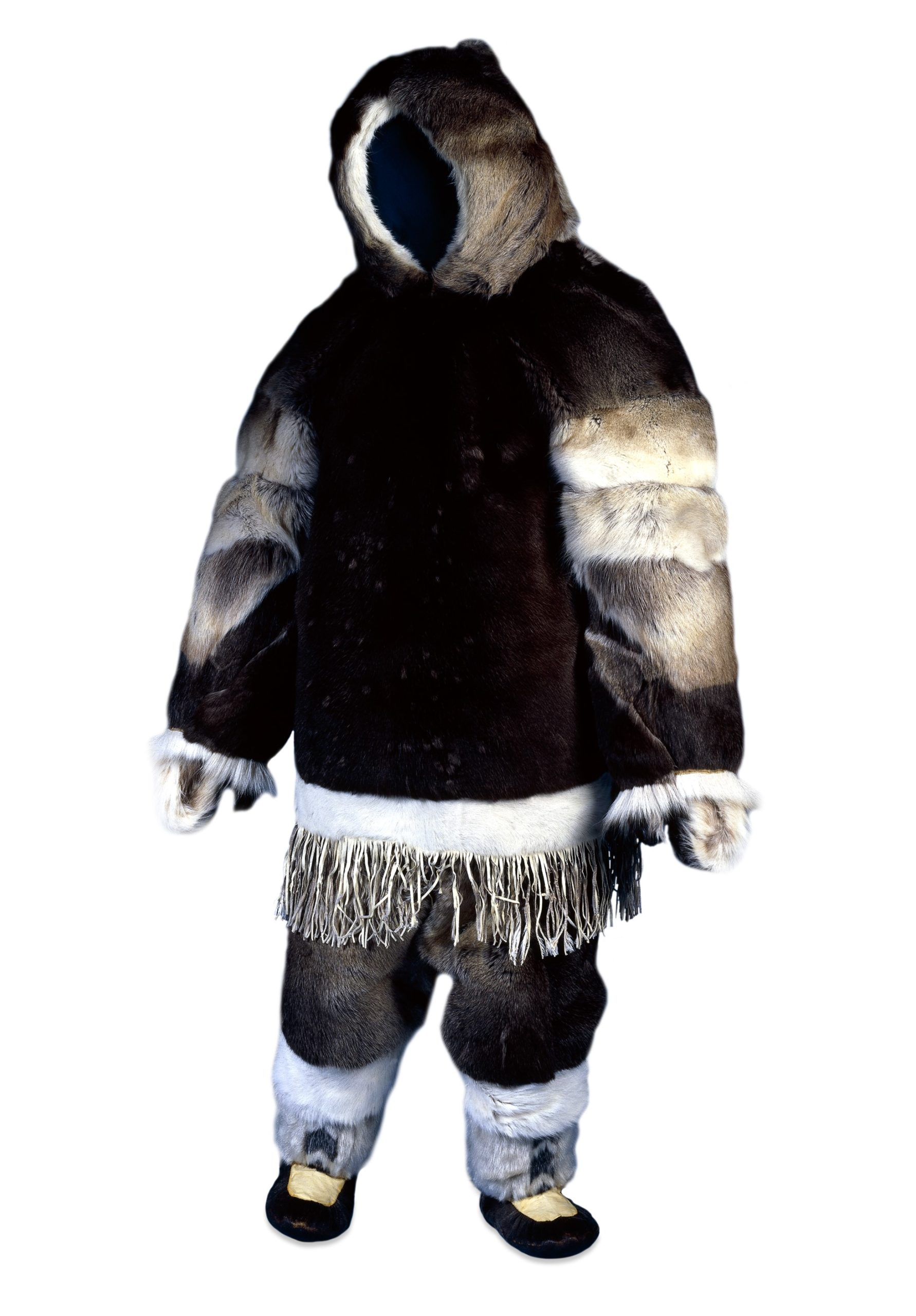 Outer parka (part of costume) made of caribou fur. The body is a very dark brown and the fur is light grey on the sleeves. It has a hood. which is lined with white fur. The bottom of the jacket is trimmed with white fur and has fringing. The trousers are made from brown fur and boots are grey and white fur.