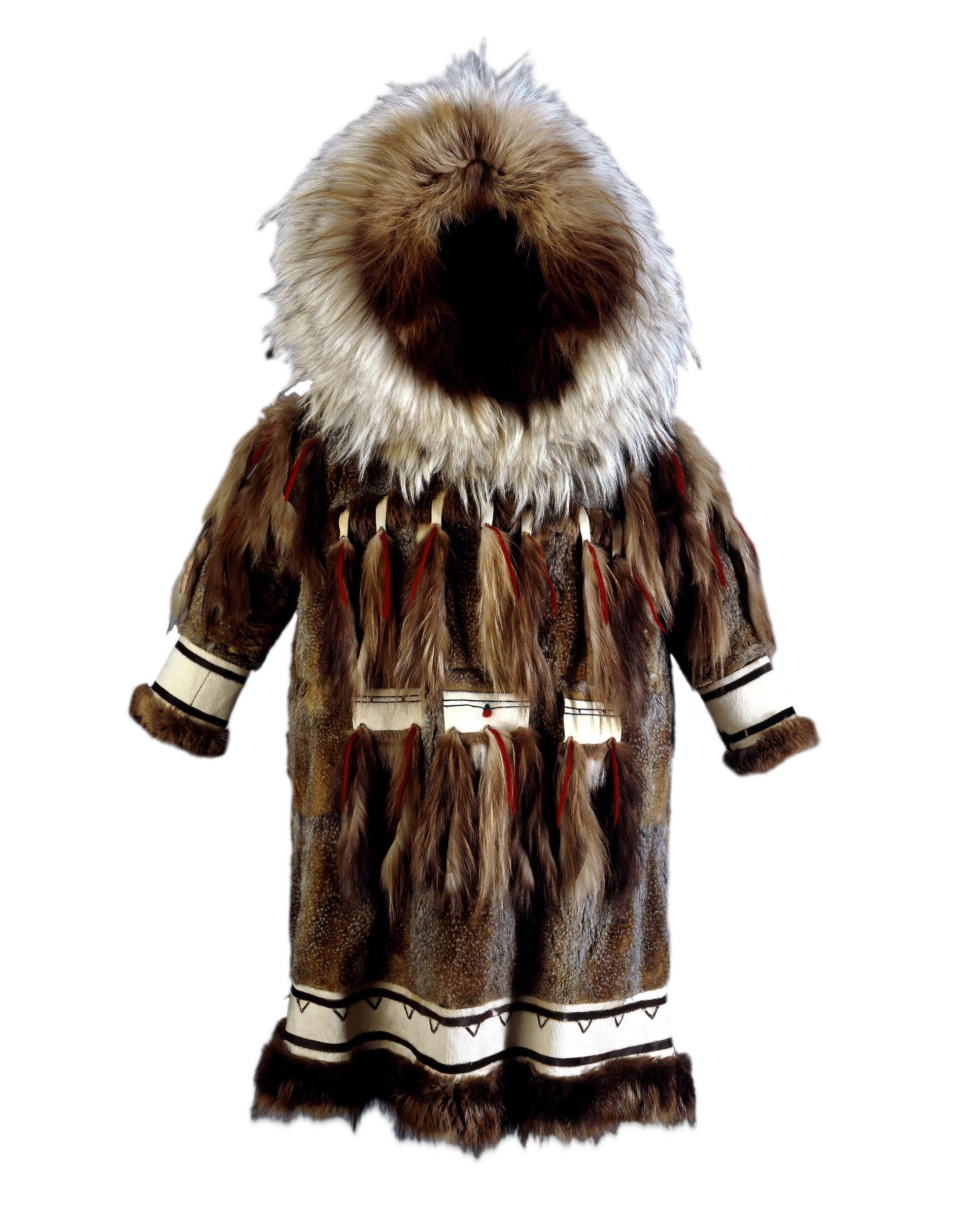 Photograph of a parka with dark brown fur, decorated with white fur at wrists and bottom hem. Three rectangles of white fur decorated with fur and red wool tassels are attached to front. It has a large fur hood.