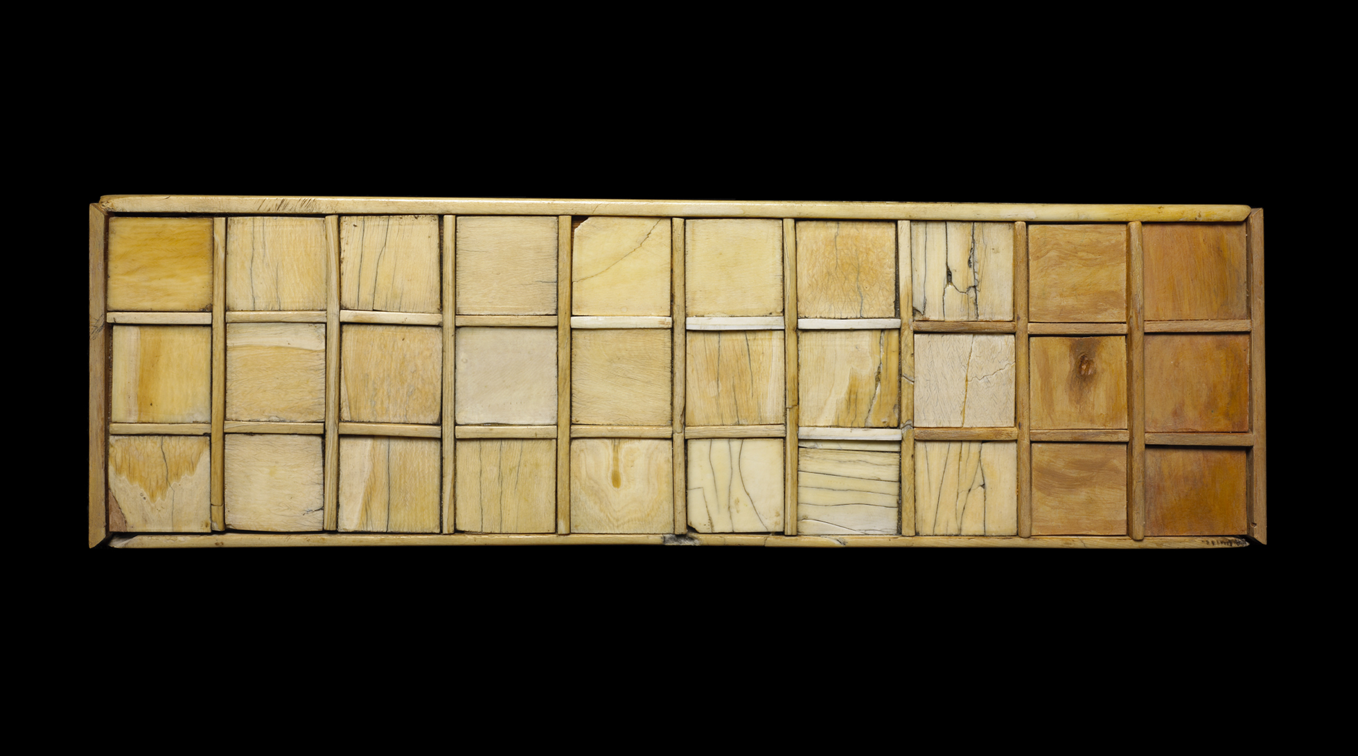 The top of an ivory game board, with a grid of 30 plain squares.
