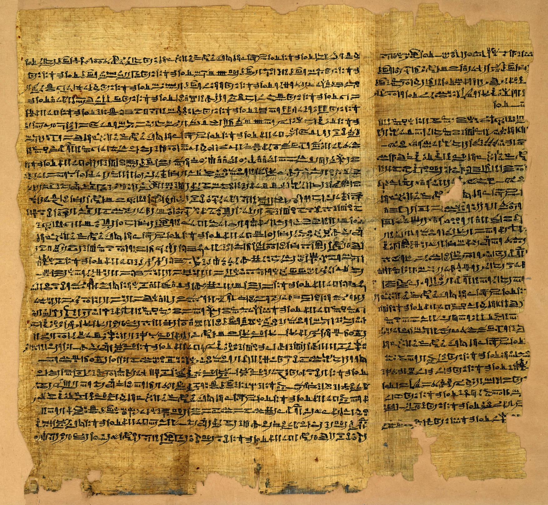 A light brown coloured papyrus covered in black ink writing.