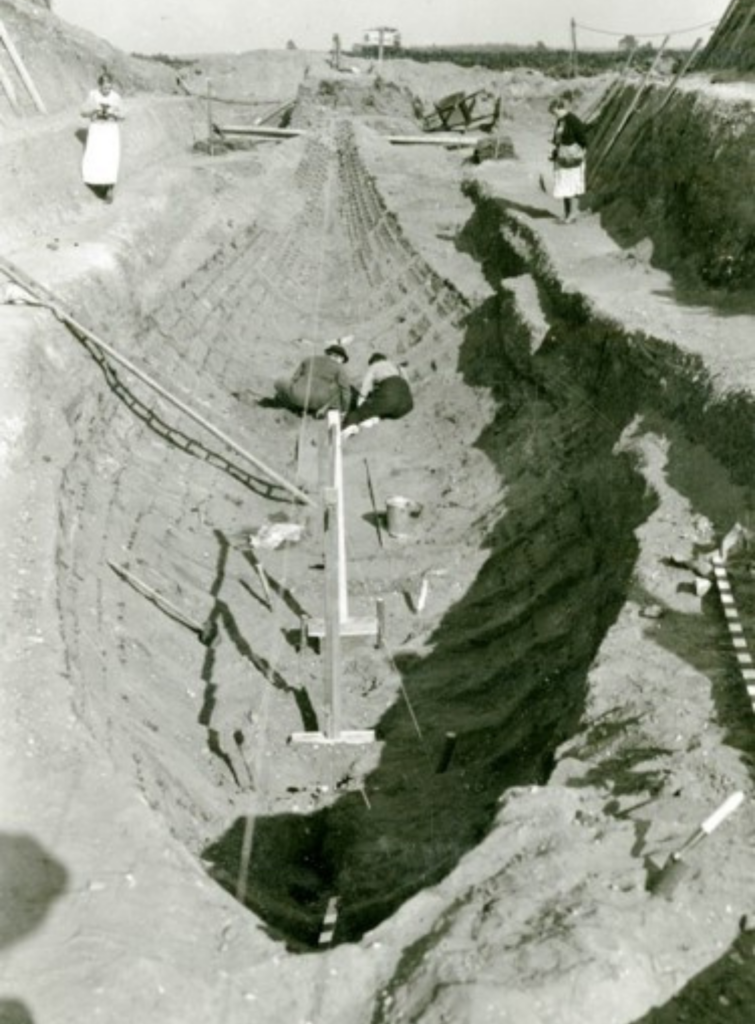 Photo showing the imprint of the Anglo-Saxon ship, buried at Sutton Hoo, and the archaeologists at work  in 1939.