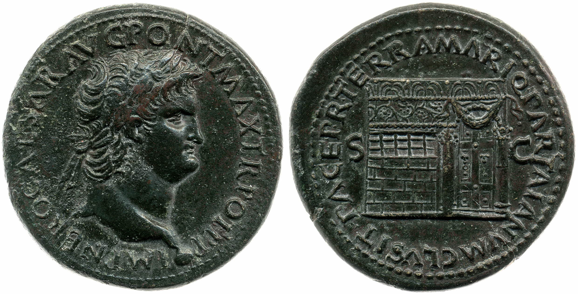 A dark coloured coin, showing a bust of Nero facing to the right on the obverse, and the fide of a temple with a window and double doors on the reverse.