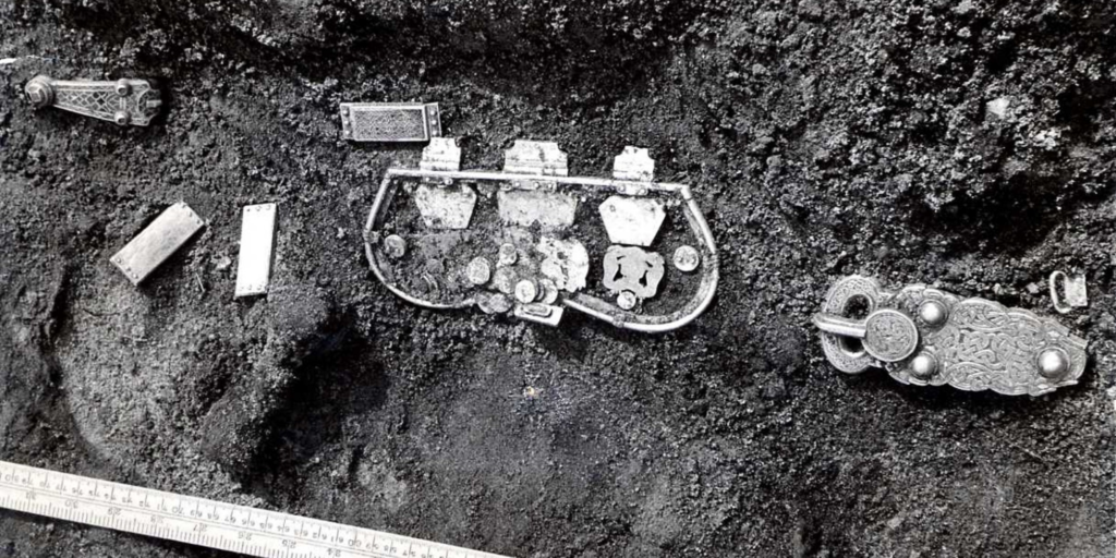 Photo of  a gold buckle, gold purse and other gold and garnet finds, discovered at Sutton Hoo.