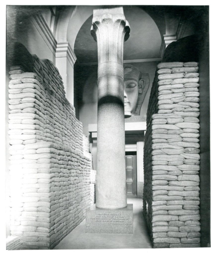 Photo of the British Museum's Egyptian gallery, filled with sandbags to protect objects from possible aerial attacks during World War I.